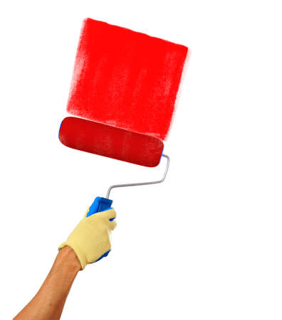 red paint roller: Mans hand holding a paint roller drawing with a red paint isolated on a white background