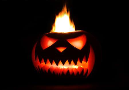 Burning Halloween Pumpkin isolated on black background