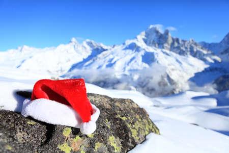 santa hat in mountains