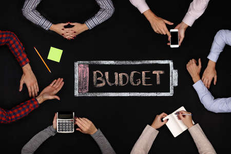 discuss: Business team of analysts discuss budget at the table Stock Photo