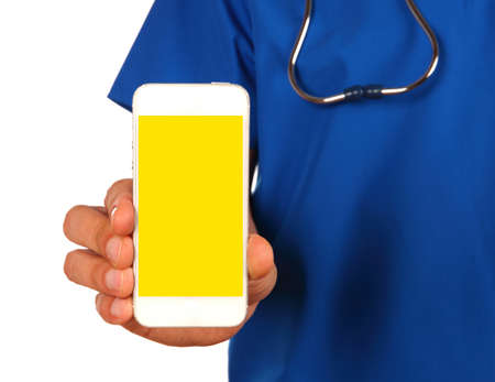 generic medicine: Male doctor with stethoscope handing a blank smartphone isolated over white isolated over white background Stock Photo