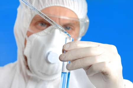 explores: Male Chemist Explores Chemical Elements in Laboratory Stock Photo