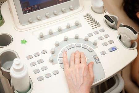 Doctor performing an ultrasound examination on specialized equipment