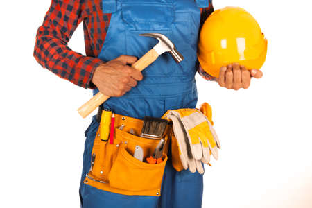 suede belt: Handyman with helmet and workers belt full of tools isolated on white background