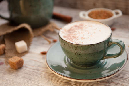 Cup of Cappuccino on wooden table Stock Photo