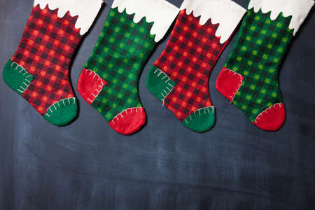 Christmas stocking on a blackboard background, xmas card
