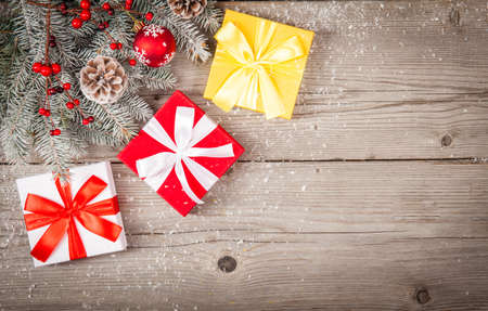 Christmas background with decorations and gift boxes on grunge wooden board. Top view Reklamní fotografie