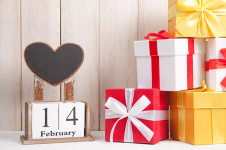 Valentines Day card with wooden block calendar. Gift box