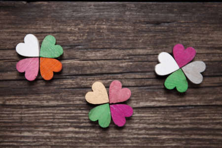 A colorful hearts on a old wooden background