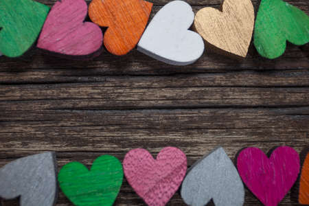 Valentines day card. A colorful hearts on a old wooden background. Copy space for text.