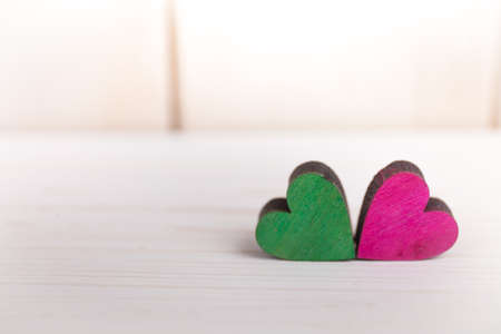 A colorful hearts on a wooden background Reklamní fotografie