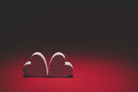 Two Hearts on red background. Valentines day card. Copy space for your text.