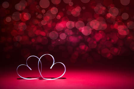 Two white Hearts on red background. Valentines day card.