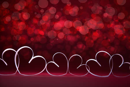 White Hearts on red background. Valentines day card. Copy space for your text.