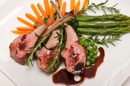 rack of lamb: Gourmet lamb chop with vegetables, herbs and balsamic vinegar
