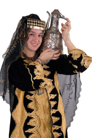 teenage girl dress: Ethnic girl wearing traditional clothing and carrying copper water jug Stock Photo