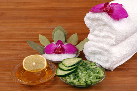 Facial masks, bath salt, orchids, and towels in a spa 写真素材