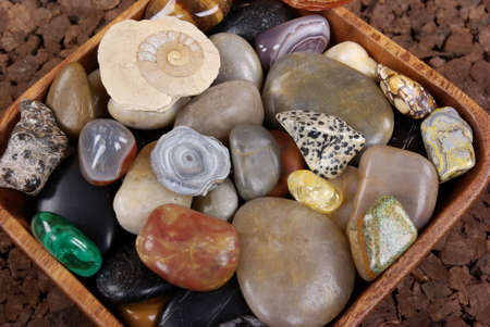 polished: Polished pebbles in a wooden bowl