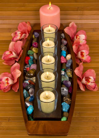 Aromatic candles, elegant orchids and semiprecious pebbles