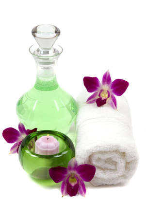 Orchids, towel, shower gel, and candle