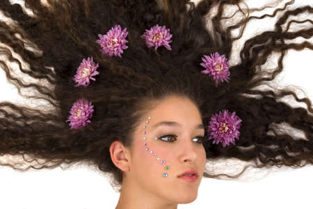 Girl with flying hair and flowers on it