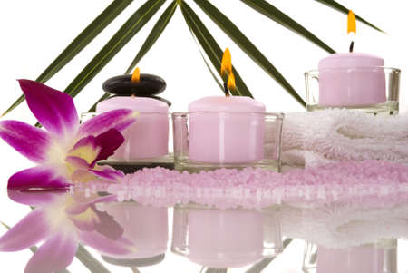 Orchids, towel, candles, pebbles and aromatic bath salt in a spa