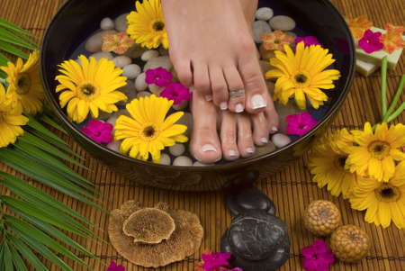 Spa treatment with aromatic gerbera daisies, healing stones, olive oil soaps and herbal water