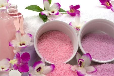 Different kinds of cyrstal bath salts, lotions, massage oils, towel, mint and exotic orchids