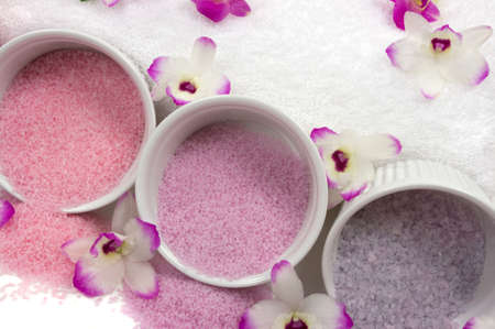 Different kinds of cyrstal bath salts and exotic orchids  photo