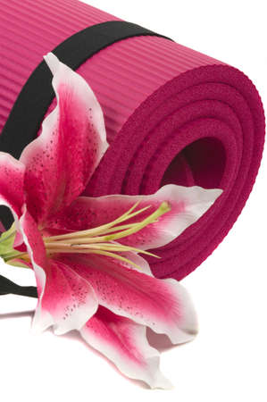 Yoga mat and a beautiful lily