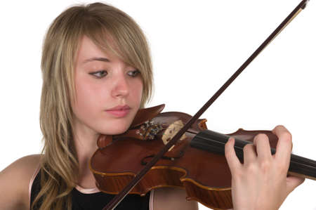 A beautiful young teenager playing her violin