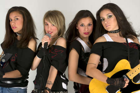 Rock band with beautiful make up and guitars