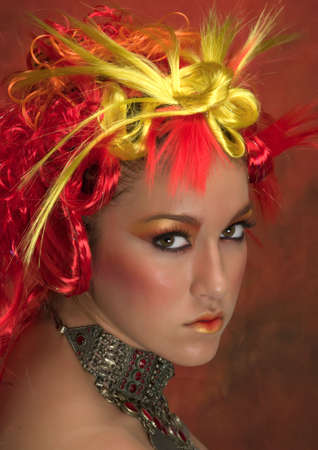 Girl with red, orange, yellow hair and beautiful make up
