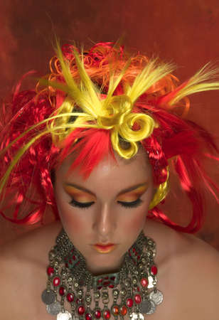 Girl with red, orange, yellow hair and beautiful make up Banco de Imagens