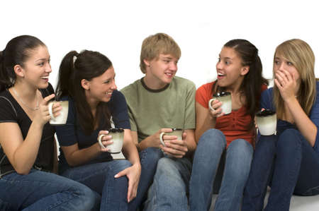 Diverse group of happy students drinking coffee/tea and chatting during their school break photo