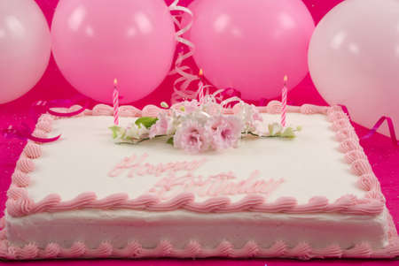 special occasions: Delicious beautifully decorated bithday cake and balloons Stock Photo