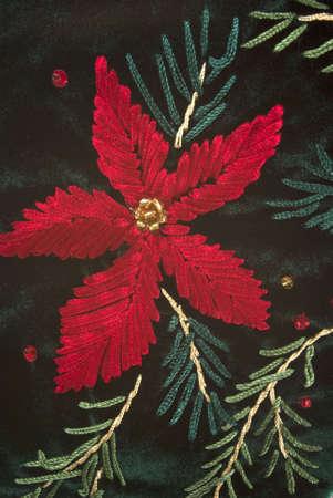 Christmas flower on velvet green stocking