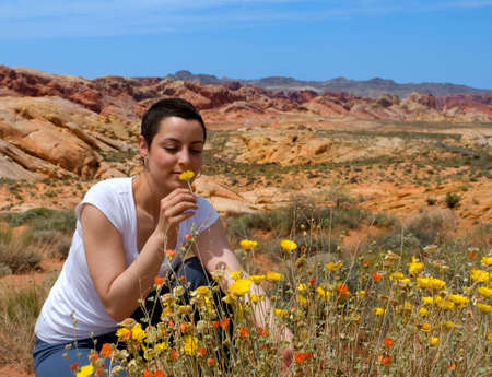 cancer patient enjoying life again after chemo treatment ( wild flowers in the desert)