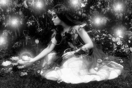 Fairy in an enchanted garden   Stock Photo