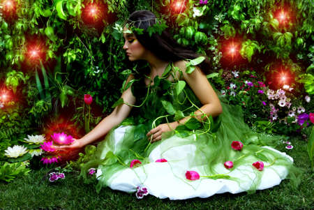 Mother Nature looking upon some of her many beautiful creations in her enchanted garden.This indoor studio shoot is a compilation of many fresh flowers, grass, tree branches and bushes.