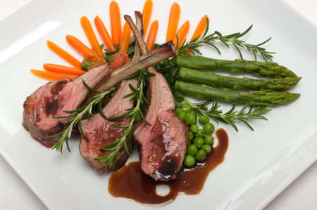 Gourmet lamb chop with vegetables, herbs and balsamic vinegar photo