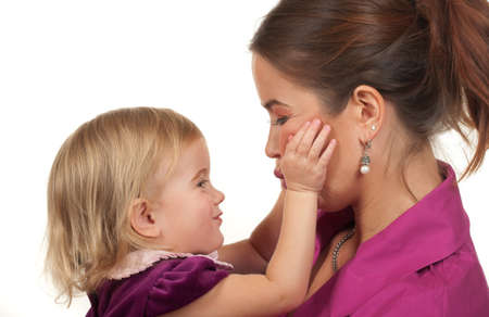Toddler loving her mom ( about to give a kiss) Banco de Imagens