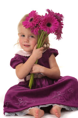 Girl giving flowers for mothers day or birthday photo