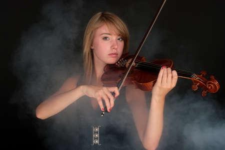 Playing violin photo