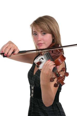 Teen playing violin photo