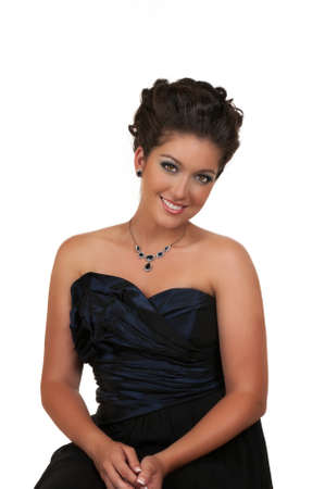 Young woman with beautiful hairstyle, make up and sapphire jewelry photo