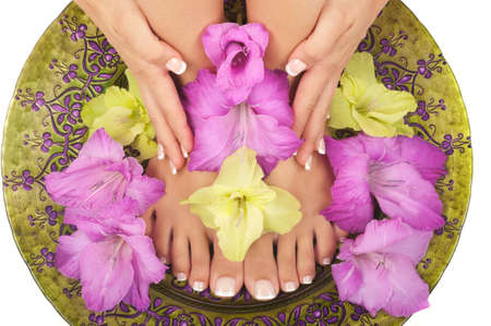 Pedicure and manicure spa with beautiful flowers photo