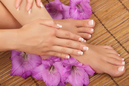 pedicure: Pedicure and manicure spa with beautiful flowers Stock Photo