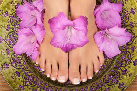 Pedicure and manicure spa with beautiful flowers Archivio Fotografico
