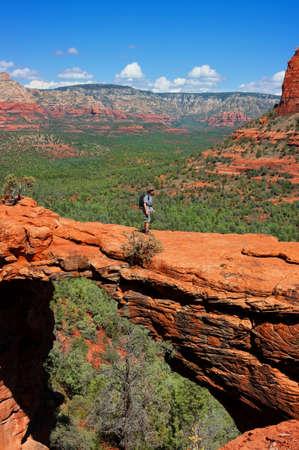sedona: Man hiking at Devils Bridge in Sedona Arizona Stock Photo